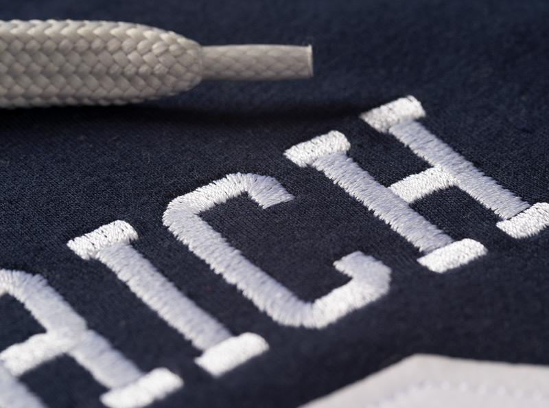 Logo auf Textilien sticken